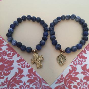 Stretch bracelet with Lapis with Miraculous Mary or 4 way Cross medallion.