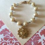 Starburst Sacred Heart with champagne pearls